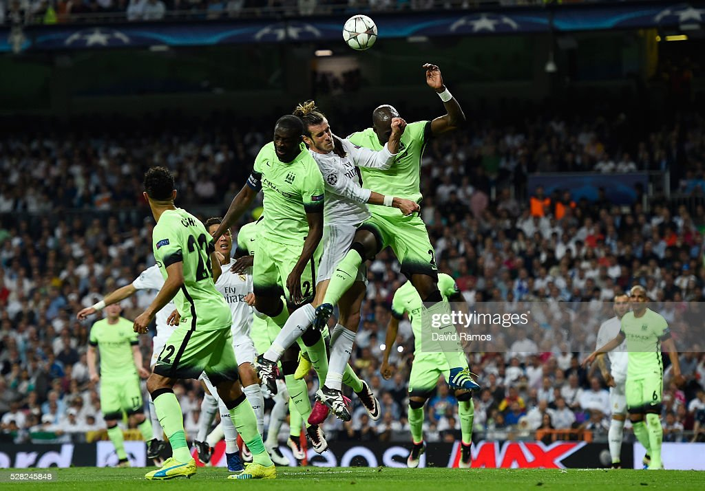 <a gi-track='captionPersonalityLinkClicked' href=/galleries/search?phrase=Gareth+Bale&family=editorial&specificpeople=609290 ng-click='$event.stopPropagation()'>Gareth Bale</a> of Real Madrid competes for a header with <a gi-track='captionPersonalityLinkClicked' href=/galleries/search?phrase=Yaya+Toure&family=editorial&specificpeople=550817 ng-click='$event.stopPropagation()'>Yaya Toure</a> and <a gi-track='captionPersonalityLinkClicked' href=/galleries/search?phrase=Eliaquim+Mangala&family=editorial&specificpeople=5713850 ng-click='$event.stopPropagation()'>Eliaquim Mangala</a> of Manchester City during the UEFA Champions League semi final, second leg match between Real Madrid and Manchester City FC at Estadio Santiago Bernabeu on May 4, 2016 in Madrid, Spain.