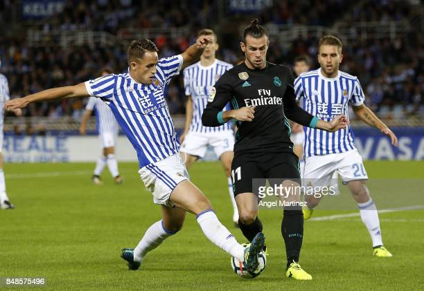Gareth Bale of Real Madrid competes for the ball with Adnan Januzaj of Real Sociedad during the La Liga match between Real Sociedad and Real Madrid...