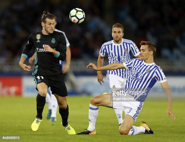 Gareth Bale of Real Madrid competes for the ball with Diego Llorente of Real Sociedad during the La Liga match between Real Sociedad and Real Madrid...