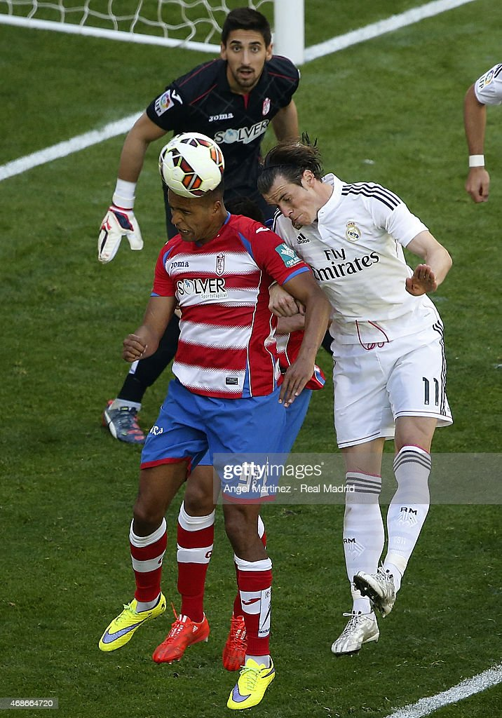 <a gi-track='captionPersonalityLinkClicked' href=/galleries/search?phrase=Gareth+Bale&family=editorial&specificpeople=609290 ng-click='$event.stopPropagation()'>Gareth Bale</a> of Real Madrid competes for the ball with Youssef El Arabi of Granada CF during the La Liga match between Real Madrid CF and Granada CF at Estadio Santiago Bernabeu on April 5, 2015 in Madrid, Spain.