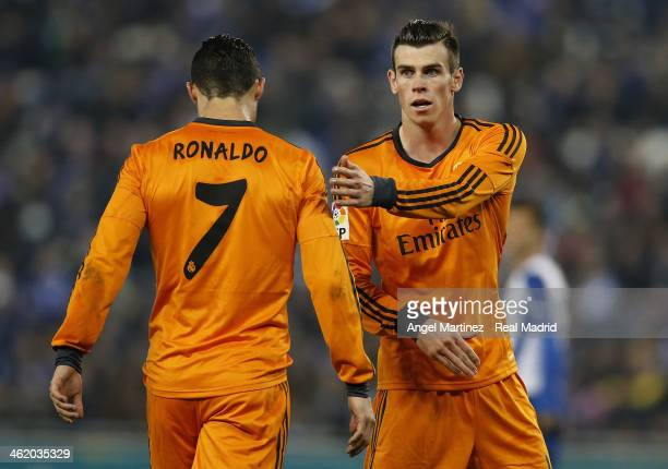 Gareth Bale of Real Madrid consoles Cristiano Ronaldo during the La Liga match between RCD Espanyol and Real Madrid at CornellaEl Prat Stadium on...