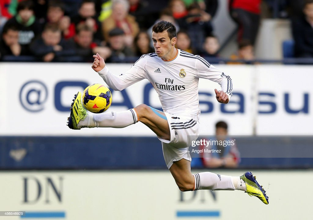 <a gi-track='captionPersonalityLinkClicked' href=/galleries/search?phrase=Gareth+Bale&family=editorial&specificpeople=609290 ng-click='$event.stopPropagation()'>Gareth Bale</a> of Real Madrid controls the ball during the La Liga match between CA Osasuna and Real Madrid at Estadio Reyno de Navarra on December 14, 2013 in Pamplona, Spain.