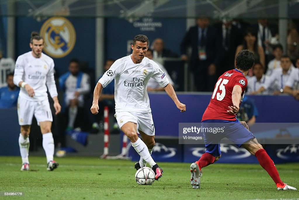 Gareth Bale of Real Madrid, Cristiano Ronaldo of Real Madrid, Stefan Savic of Club Atletico de Madrid during the UEFA Champions League final match between Real Madrid and Atletico Madrid on May 28, 2016 at the Giuseppe Meazza San Siro stadium in Milan, Italy.