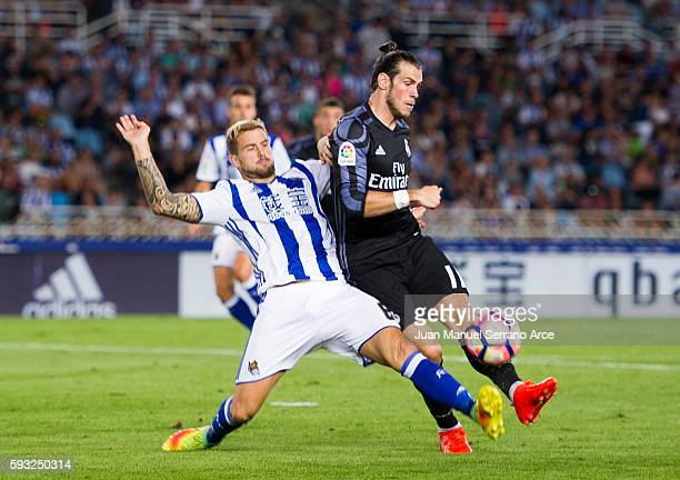 Gareth Bale of Real Madrid duels for the ball with Inigo Martinez of Real Sociedad during the La Liga match between Real Sociedad de Futbol and Real...