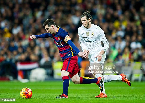 Gareth Bale of Real Madrid duels for the ball with Lionel Messi of Barcelona during the La Liga match between Real Madrid CF and FC Barcelona at...
