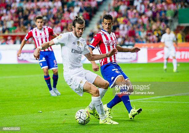 Gareth Bale of Real Madrid duels for the ball with Luis Hernandez of Real Sporting de Gijon during the La Liga match between Sporting Gijon and Real...
