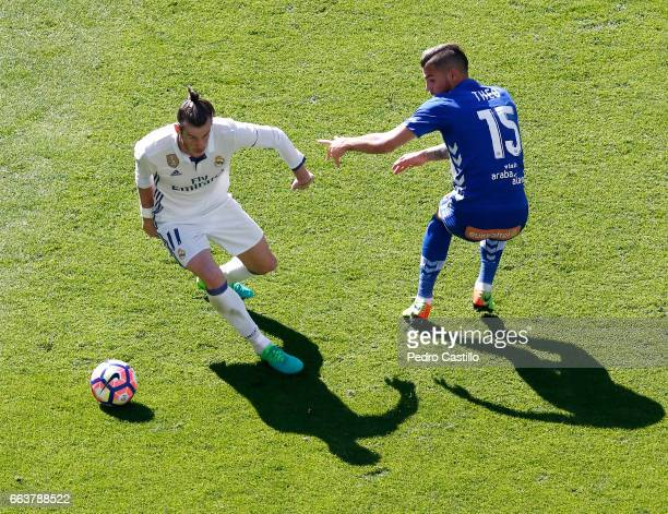 Gareth Bale of Real Madrid duels for the ball with Theo Hernandez of Deportivo Alaves during the La Liga match between Real Madrid and Deportivo...