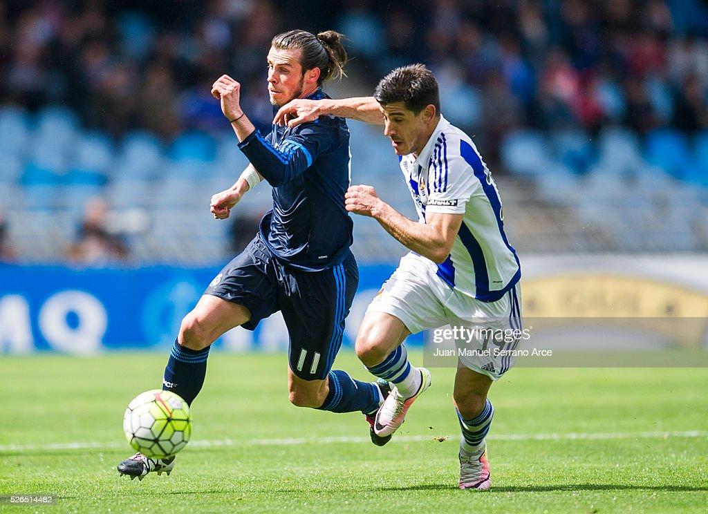Gareth Bale of Real Madrid duels for the ball with Yuri Berchiche of Real Sociedad during the La Liga match between Real Sociedad de Futbol and Real Madrid at Estadio Anoeta on April 30, 2016 in San Sebastian, Spain.