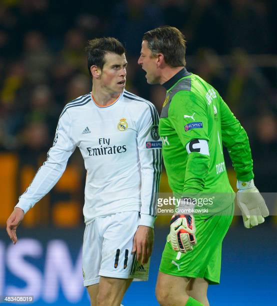 Gareth Bale of Real Madrid exchanges words with goalkeeper Roman Weidenfeller of Borussia Dortmund during the UEFA Champions League Quarter Final...