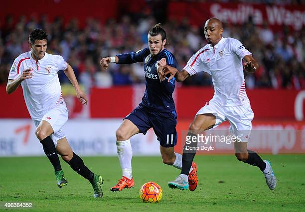 Gareth Bale of Real Madrid gets past Marco Andreolli and Steven N'Zonzi of Sevilla FC during the La Liga match between Sevilla FC and Real Madrid CF...
