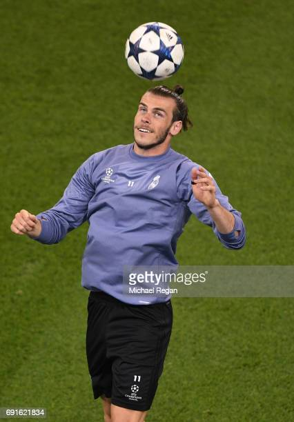 Gareth Bale of Real Madrid heads a ball during a Real Madrid training session prior to the UEFA Champions League Final between Juventus and Real...