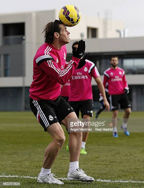 Gareth Bale of Real Madrid heads the ball during a training session at Valdebebas training ground on February 12 2015 in Madrid Spain