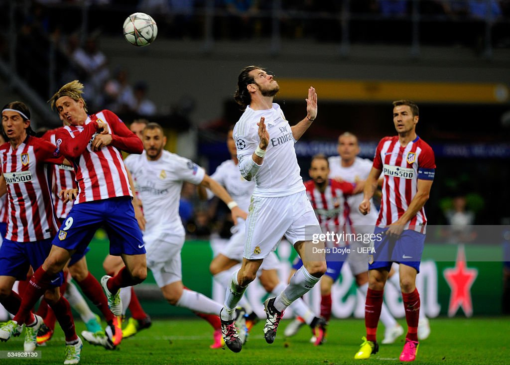 <a gi-track='captionPersonalityLinkClicked' href=/galleries/search?phrase=Gareth+Bale&family=editorial&specificpeople=609290 ng-click='$event.stopPropagation()'>Gareth Bale</a> of Real Madrid heads the ball during the UEFA Champions League Final between Real Madrid and Club Atletico de Madrid at Stadio Giuseppe Meazza on May 28, 2016 in Milan, Italy.