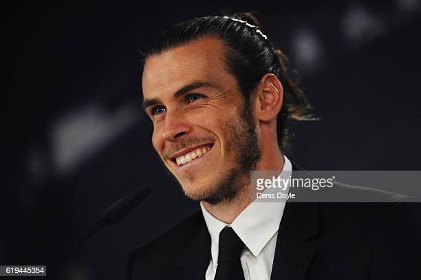 Gareth Bale of Real Madrid holds a press conference at the Santiago Bernabeu stadium after extending his contract with Real until 2022 on October 31...