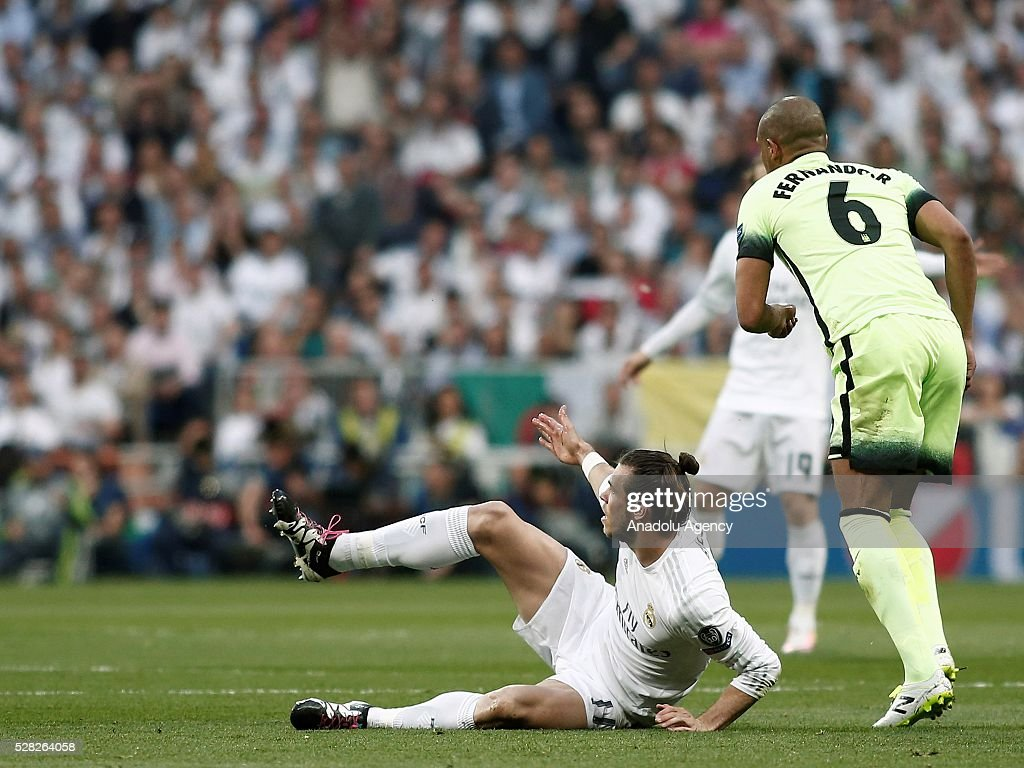 Gareth Bale (L) of Real Madrid in action against Fernando of Manchester City during the UEFA Champions League semi-final second leg football match between Real Madrid and Manchester City at the Santiago Bernabeu Stadium in Madrid, Spain on May 4, 2016.