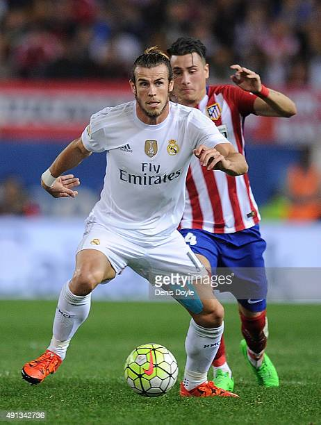 Gareth Bale of Real Madrid in action beside Guilherme Siqueira of Club Atletico de Madrid during the La Liga match between Club Atletico de Madrid...