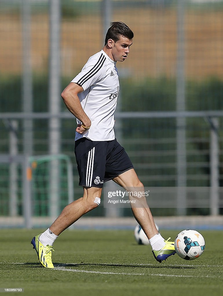 <a gi-track='captionPersonalityLinkClicked' href=/galleries/search?phrase=Gareth+Bale&family=editorial&specificpeople=609290 ng-click='$event.stopPropagation()'>Gareth Bale</a> of Real Madrid in action during a training session at Valdebebas training ground on September 12, 2013 in Madrid, Spain.