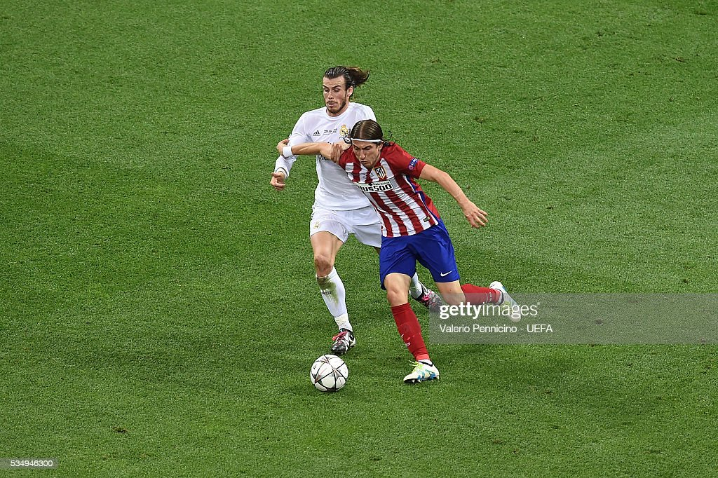 <a gi-track='captionPersonalityLinkClicked' href=/galleries/search?phrase=Gareth+Bale&family=editorial&specificpeople=609290 ng-click='$event.stopPropagation()'>Gareth Bale</a> (L) of Real Madrid is challenged by <a gi-track='captionPersonalityLinkClicked' href=/galleries/search?phrase=Filipe+Luis&family=editorial&specificpeople=3941966 ng-click='$event.stopPropagation()'>Filipe Luis</a> of Club Atletico de Madrid during the UEFA Champions League Final between Real Madrid and Club Atletico de Madrid at Stadio Giuseppe Meazza on May 28, 2016 in Milan, Italy.