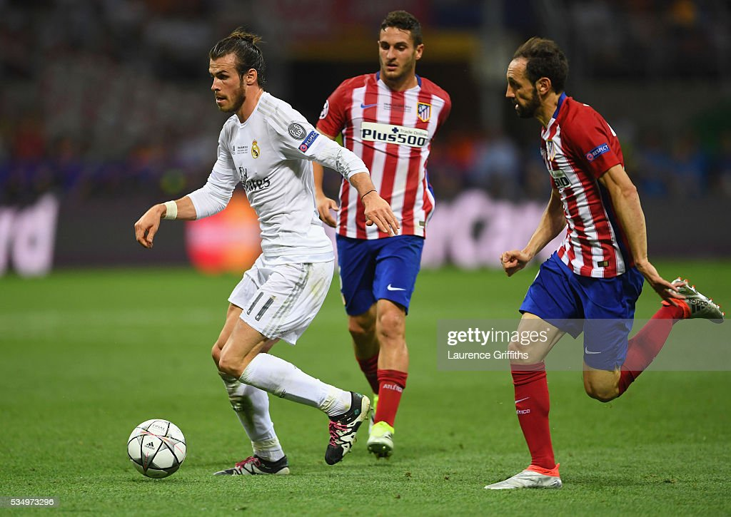 <a gi-track='captionPersonalityLinkClicked' href=/galleries/search?phrase=Gareth+Bale&family=editorial&specificpeople=609290 ng-click='$event.stopPropagation()'>Gareth Bale</a> of Real Madrid is challenged by <a gi-track='captionPersonalityLinkClicked' href=/galleries/search?phrase=Juanfran+-+Soccer+Right+Back+born+1985&family=editorial&specificpeople=2634439 ng-click='$event.stopPropagation()'>Juanfran</a> of Atletico Madrid during the UEFA Champions League Final match between Real Madrid and Club Atletico de Madrid at Stadio Giuseppe Meazza on May 28, 2016 in Milan, Italy.