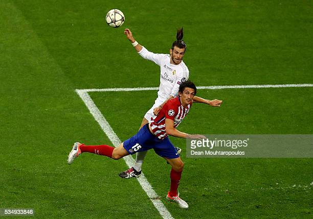 Gareth Bale of Real Madrid is challenged by Stefan Savic of Atletico Madrid during the UEFA Champions League Final match between Real Madrid and Club...