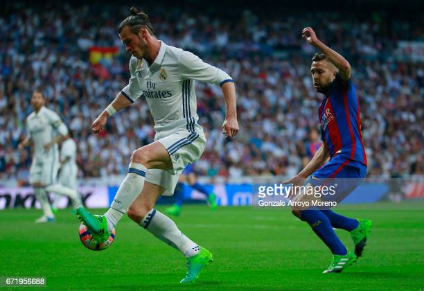 Gareth Bale of Real Madrid is chased by Jordi Alba of Barcelona during the La Liga match between Real Madrid CF and FC Barcelona at Estadio Bernabeu...