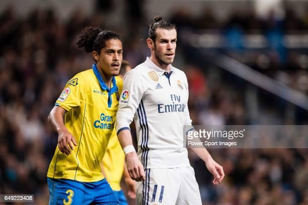 Gareth Bale of Real Madrid is chased by Mauricio Lemos of UD Las Palmas during their La Liga match between Real Madrid vs Las Palmas at the Santiago...