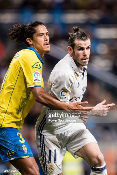 Gareth Bale of Real Madrid is chased by Mauricio Lemos of UD Las Palmas during their La Liga match between Real Madrid vs Las Palmas at the Santiago...