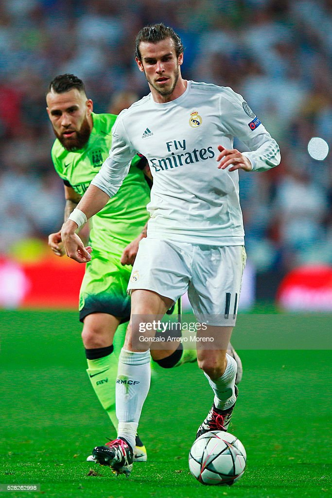 Gareth Bale of Real Madrid is pursued by Nicolas Otamendi of Manchester City during the UEFA Champions League semi final, second leg match between Real Madrid and Manchester City FC at Estadio Santiago Bernabeu on May 4, 2016 in Madrid, Spain.