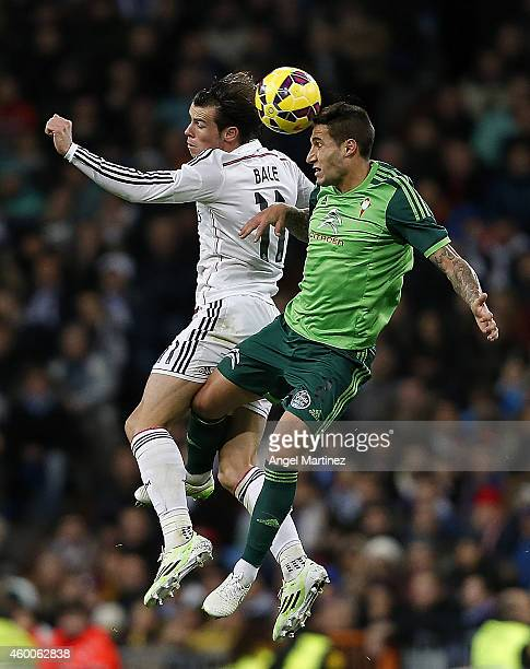 Gareth Bale of Real Madrid jumps for the ball against Hugo Mallo of Celta de Vigo during the La Liga match between Real Madrid and Celta de Vigo at...