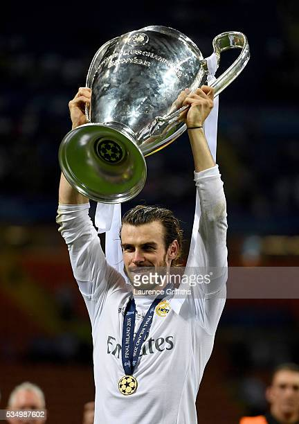 Gareth Bale of Real Madrid lifts the Champions League trophy after the UEFA Champions League Final match between Real Madrid and Club Atletico de...