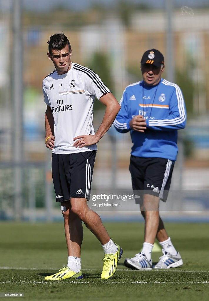 <a gi-track='captionPersonalityLinkClicked' href=/galleries/search?phrase=Gareth+Bale&family=editorial&specificpeople=609290 ng-click='$event.stopPropagation()'>Gareth Bale</a> (L) of Real Madrid looks on alongside head coach <a gi-track='captionPersonalityLinkClicked' href=/galleries/search?phrase=Carlo+Ancelotti&family=editorial&specificpeople=226747 ng-click='$event.stopPropagation()'>Carlo Ancelotti</a> during a training session at Valdebebas training ground on September 12, 2013 in Madrid, Spain.