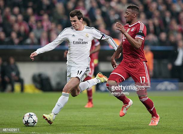 Gareth Bale of Real Madrid makes a break past Jerome Boateng of Bayern Muenchen leading to Cristiano Ronaldo's goal during the UEFA Champions League...