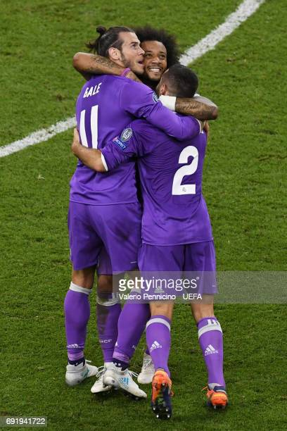 Gareth Bale of Real Madrid Marcelo of Real Madrid and Daniel Carvajal of Real Madrid celebrate after the UEFA Champions League Final between Juventus...