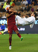 Gareth Bale of Real Madrid performs a scissor kick against Ashley Cole of AS Romas during the international friendly match between Real Madrid and AS...