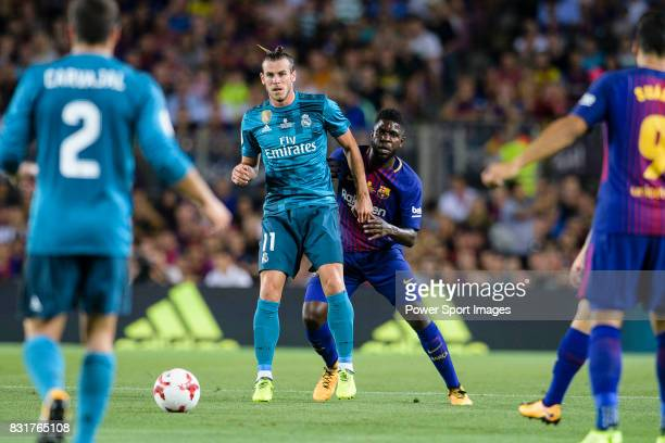 Gareth Bale of Real Madrid plays against Samuel Umtiti of FC Barcelona during the Supercopa de Espana Final 1st Leg match between FC Barcelona and...