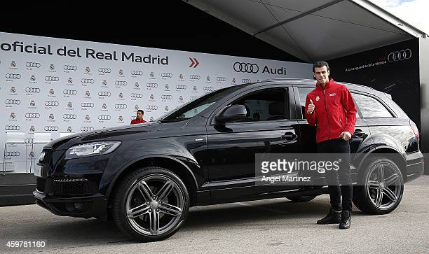 Gareth Bale of Real Madrid poses during the car handover of Audi at Ciudad Real Madrid on December 1 2014 in Madrid Spain