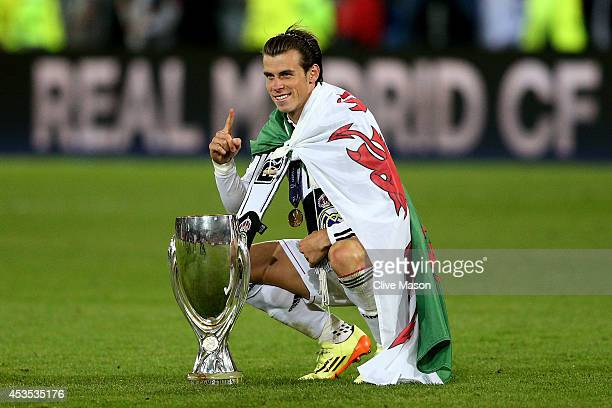 Gareth Bale of Real Madrid poses with the trophy following his team's 20 victory during the UEFA Super Cup between Real Madrid and Sevilla FC at...