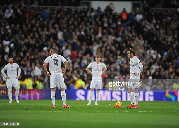 Gareth Bale of Real Madrid reacts after Brcelona scored their opening goal after scoring his team's opening goal during the La Liga match between...