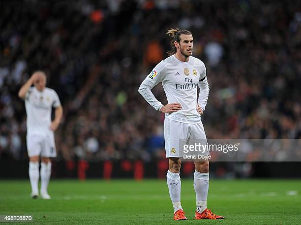 Gareth Bale of Real Madrid reacts after FC Barcelona scored their 2nd goal during the La Liga match between Real Madrid and Barcelona at Estadio...