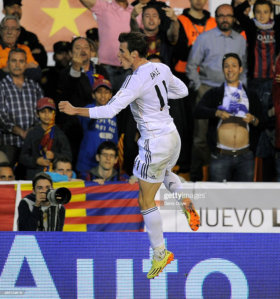 Gareth Bale of Real Madrid reacts after scoring Real's 2nd goal during the Copa del Rey Final between Real Madrid and Barcelona at Estadio Mestalla on April 16, 2014 in Valencia, Spain.