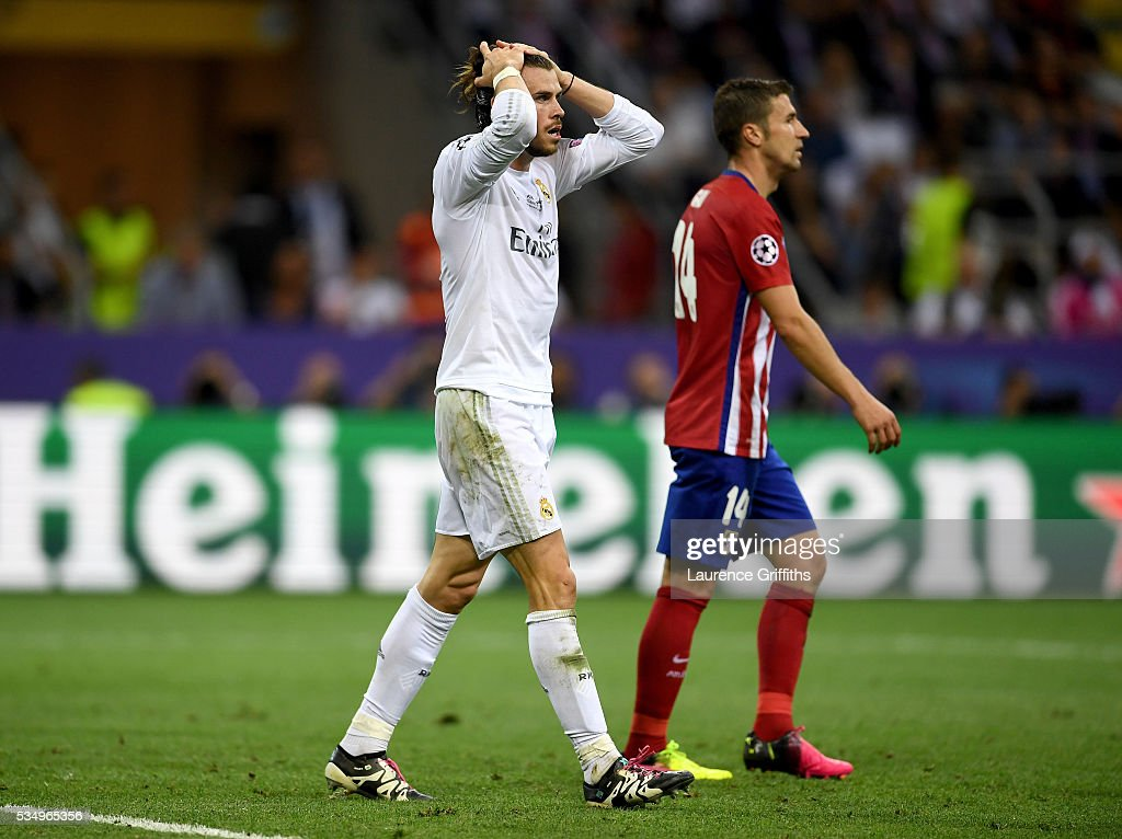 <a gi-track='captionPersonalityLinkClicked' href=/galleries/search?phrase=Gareth+Bale&family=editorial&specificpeople=609290 ng-click='$event.stopPropagation()'>Gareth Bale</a> of Real Madrid reacts during the UEFA Champions League Final match between Real Madrid and Club Atletico de Madrid at Stadio Giuseppe Meazza on May 28, 2016 in Milan, Italy.