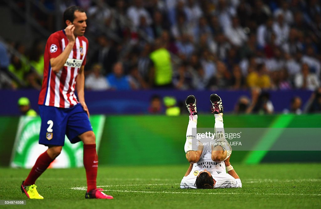 <a gi-track='captionPersonalityLinkClicked' href=/galleries/search?phrase=Gareth+Bale&family=editorial&specificpeople=609290 ng-click='$event.stopPropagation()'>Gareth Bale</a> of Real Madrid reacts during the UEFA Champions League Final between Real Madrid and Club Atletico de Madrid at Stadio Giuseppe Meazza on May 28, 2016 in Milan, Italy.