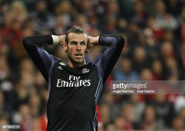 Gareth Bale of Real Madrid reacts during the UEFA Champions League Quarter Final first leg match between FC Bayern Muenchen and Real Madrid CF at...