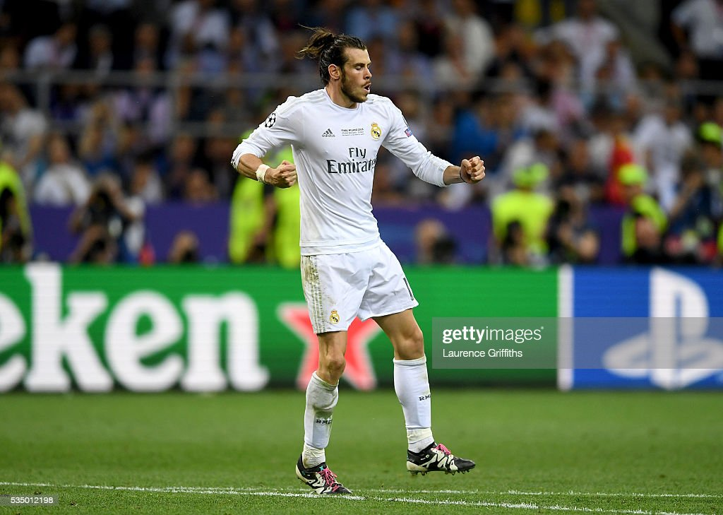 <a gi-track='captionPersonalityLinkClicked' href=/galleries/search?phrase=Gareth+Bale&family=editorial&specificpeople=609290 ng-click='$event.stopPropagation()'>Gareth Bale</a> of Real Madrid reacts in celebration after scoring his penalty during the UEFA Champions League Final match between Real Madrid and Club Atletico de Madrid at Stadio Giuseppe Meazza on May 28, 2016 in Milan, Italy.