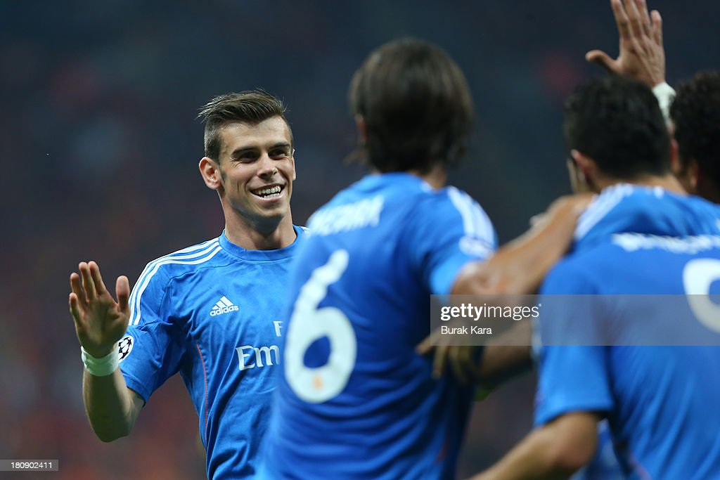 Gareth Bale of Real Madrid runs to his teammates as he celebrates the goal against Galatasaray during UEFA Champions League Group B match at the Ali Sami Yen Area on September 17, 2013 in Istanbul, Turkey.