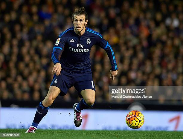 Gareth Bale of Real Madrid runs with the ball during the La Liga match between Valencia CF and Real Madrid CF at Estadi de Mestalla on January 03...
