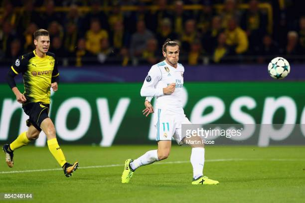 Gareth Bale of Real Madrid scores his sides first goal during the UEFA Champions League group H match between Borussia Dortmund and Real Madrid at...