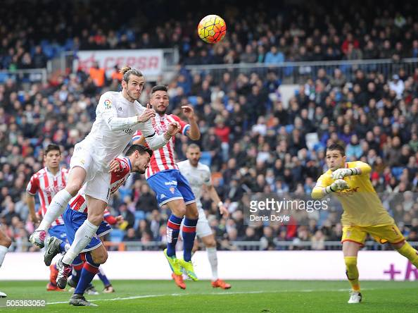 Gareth Bale of Real Madrid scores his team's opening goal during the La Liga match between Real Madrid CF and Sporting Gijon at Estadio Santiago...