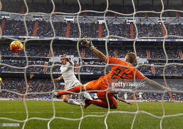 Gareth Bale of Real Madrid scores his team's seventh goal past Yoel Rodriguez of Rayo Vallecano during the La Liga match between Real Madrid CF and...