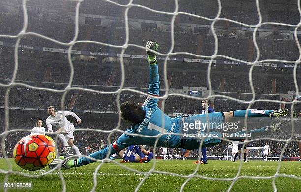 Gareth Bale of Real Madrid scores his team's third goal past German Lux of Deportivo La Coruna during the La Liga match between Real Madrid CF and RC...